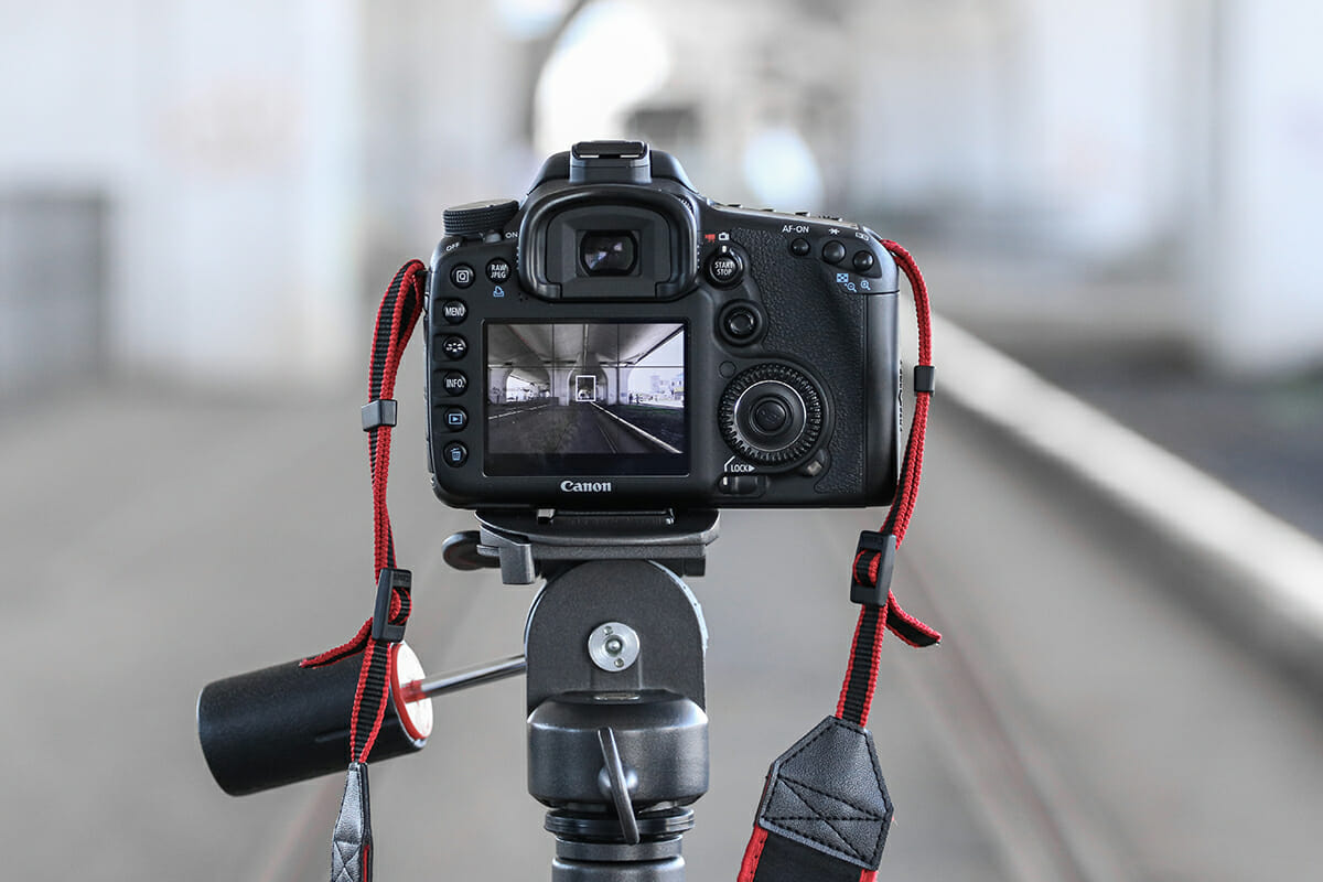 view of camera screen on tripod red strap sharp photographs