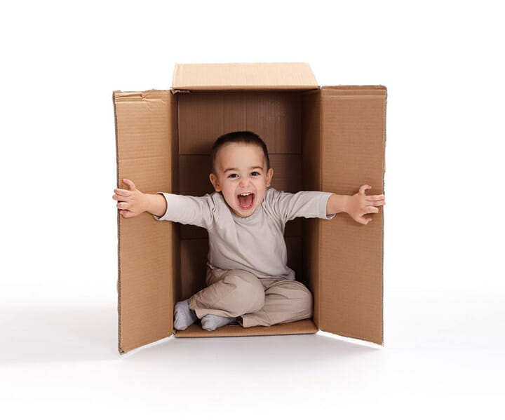 child bursting out of a box