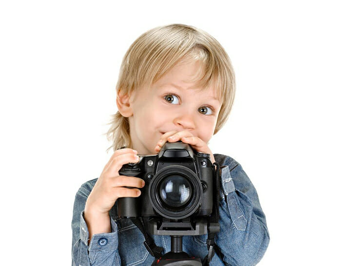 child looking over camera