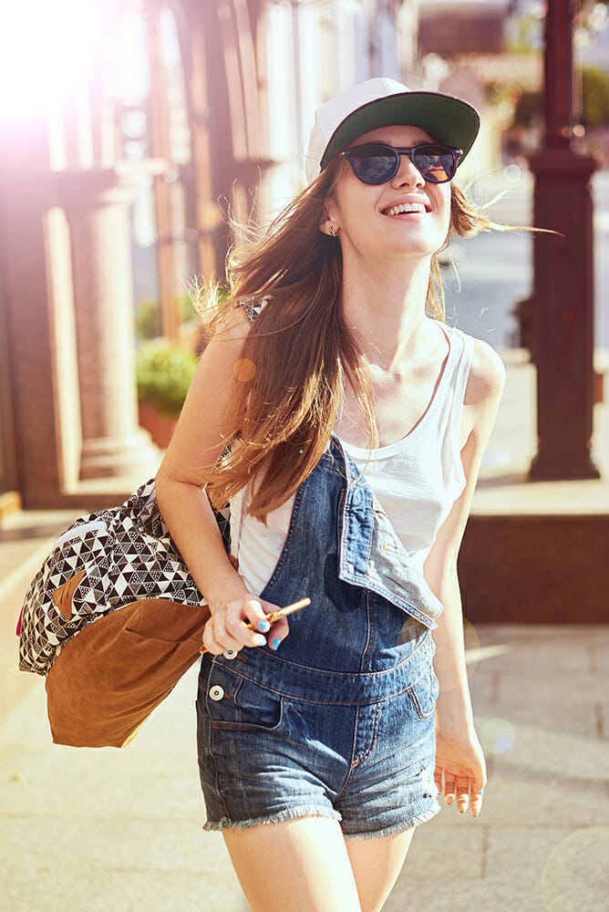 lady female girl sunglasses bag sun flare travel adventure photography happy
