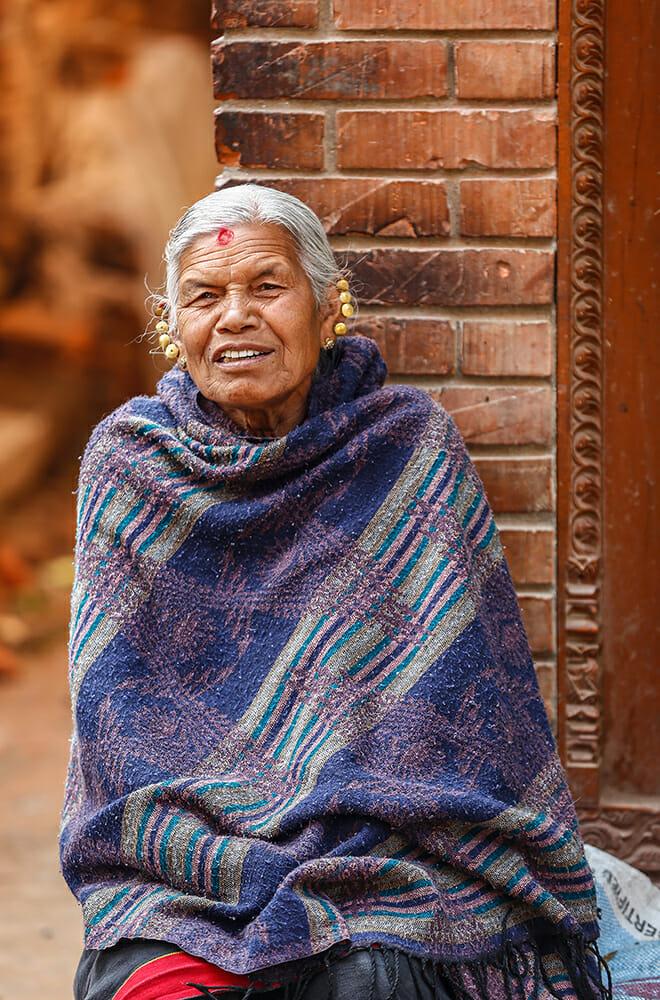 lady wrap shawl travel photography village elder orange