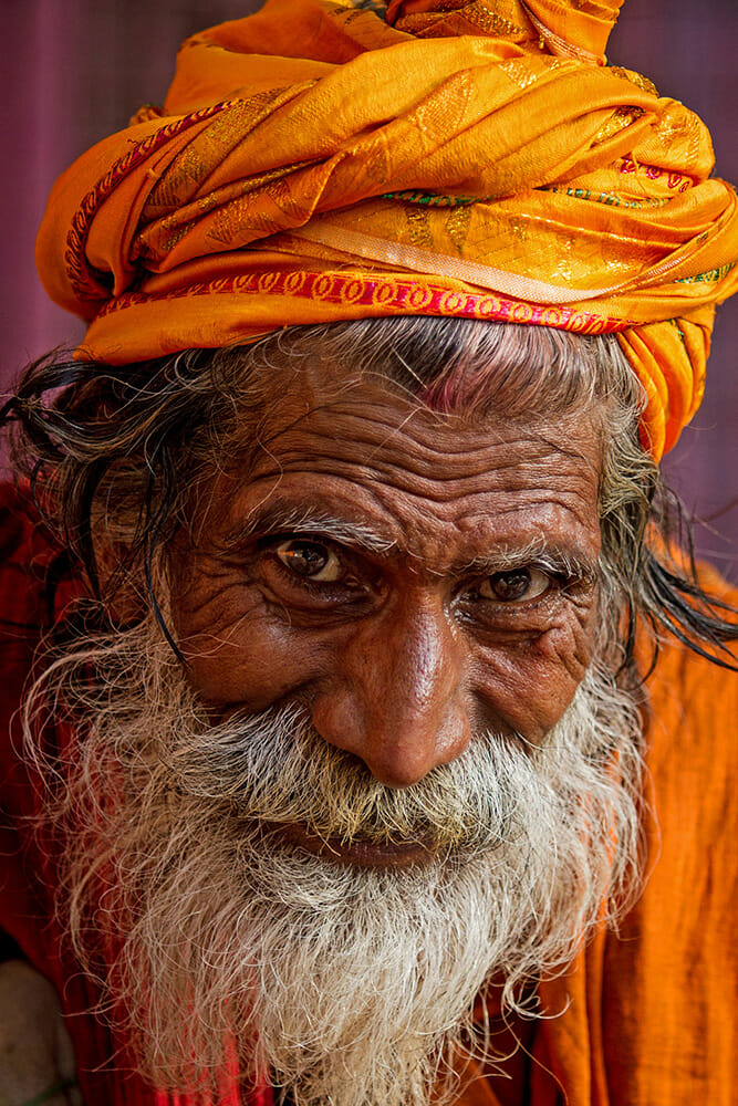 elder man male orange clothing wrinkles detail photography travel