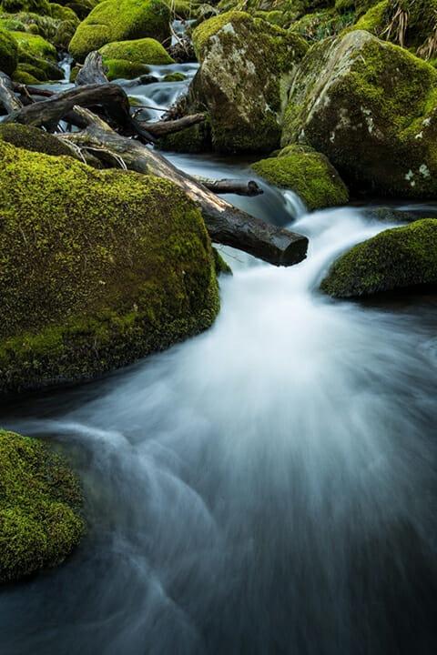waterfall water green rocks moss calm slow shutter speed
