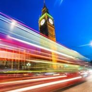 london bridge big ben houses of parliament light trails bus blue sky red white starburst long exposure motion blue