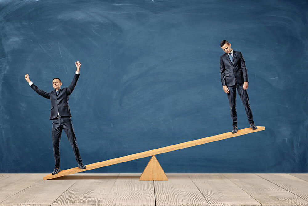 men balance see-saw suits creative block