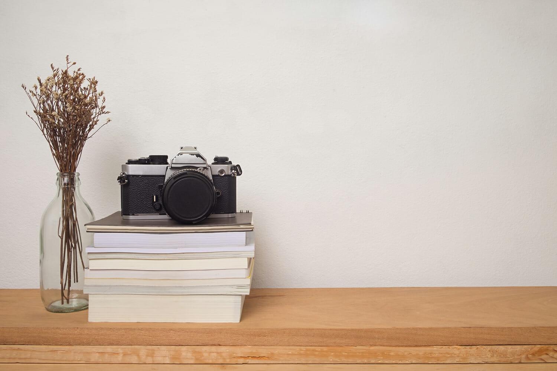 camera film photography books desk creative block