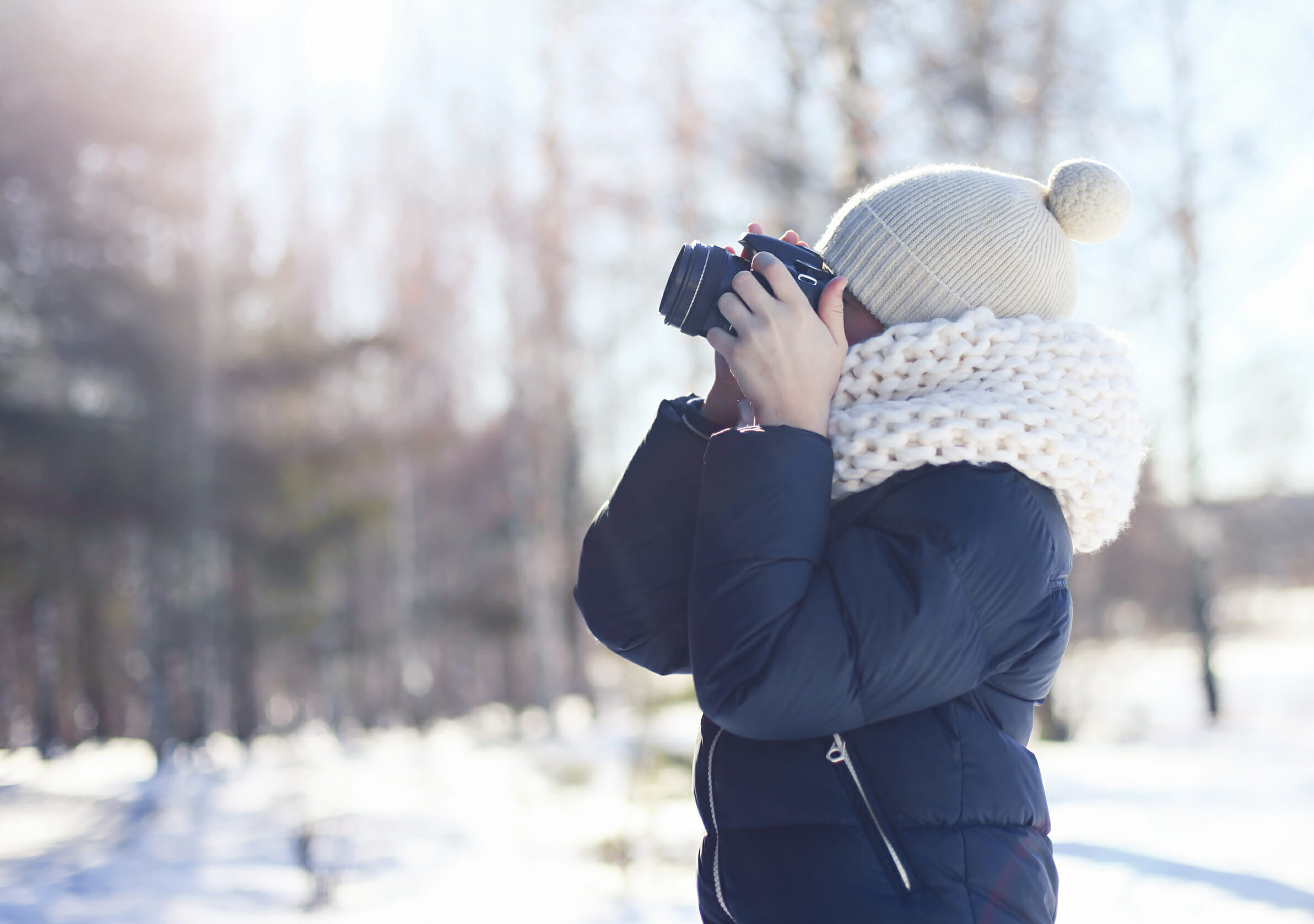 child camera winter photography hat bobble jacket snow cold