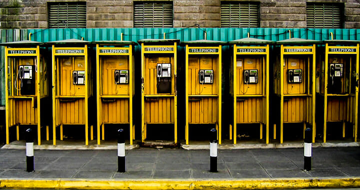 yellow phone boxes telephone in a row street photography portrait city people camera subject light how to tutorial guide