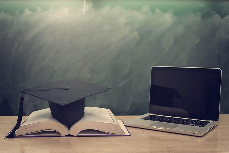 college degree graduation cap computer online training course
