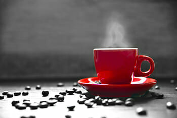 red coffee cup beans black and white hot steam