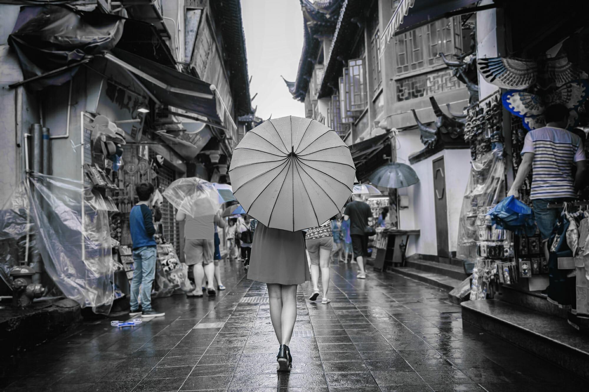 lady umbrella city market blue walking