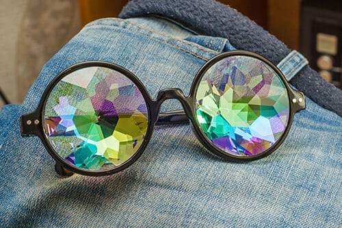 kaleidoscope glasses on jeans