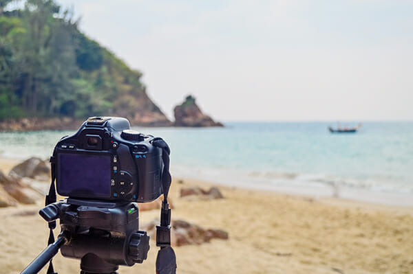 camera on tripod beach photography levitation