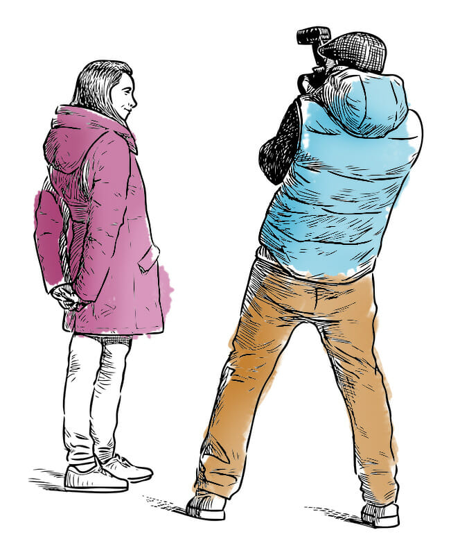 man taking photograph of lady in the street