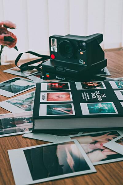 polaroid camera on photo book