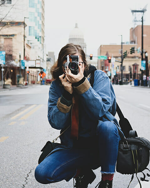 photographer taking picture on street