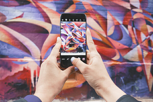 photograph urban graffiti purple smartphone