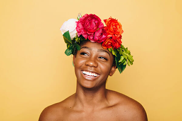 lady with floral headpiece laughing