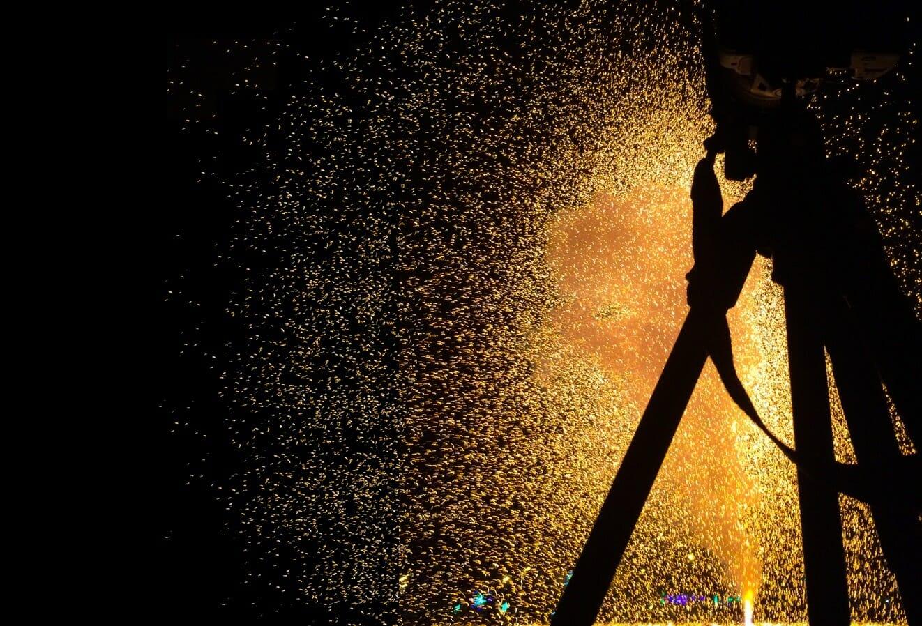 firework explosion camera tripod yellow orange