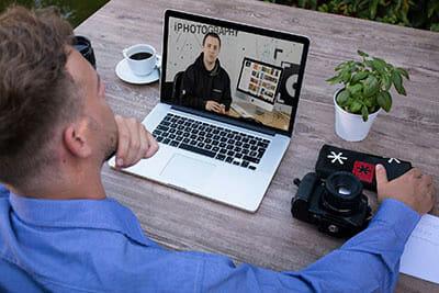 man watching video critique feedback