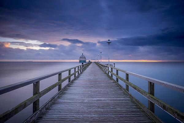 blue hour seaside pier jetty night time
