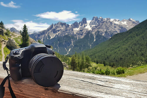 camera on ledge mountains in background landscape photography