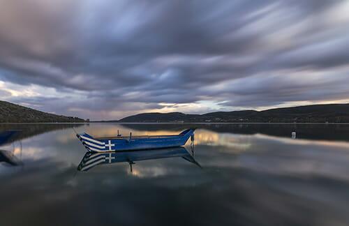 blurry clouds in sky water in boat