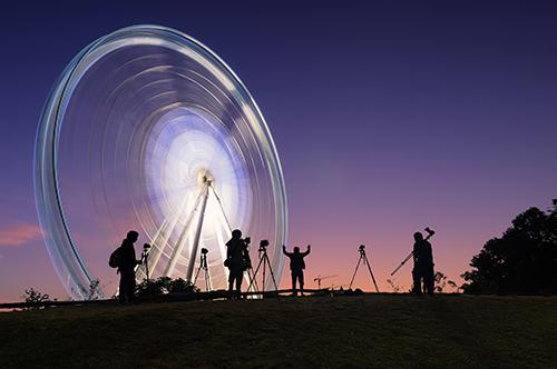 big wheel funfair sunset photographers flash photography