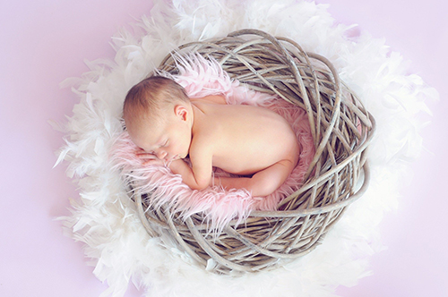 newborn on pink and white background