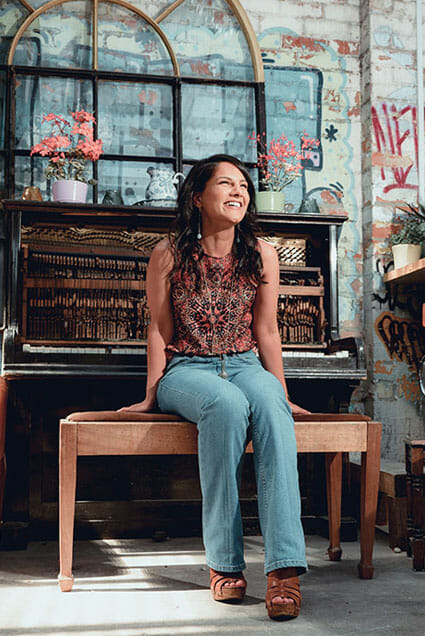 a good portrait cropping example a woman by a broken piano