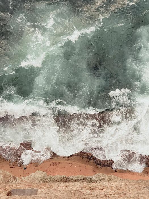 crashing waves expensive camera equipment