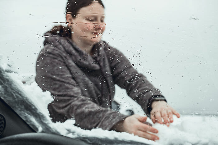wiping snow off a car expensive camera equipment