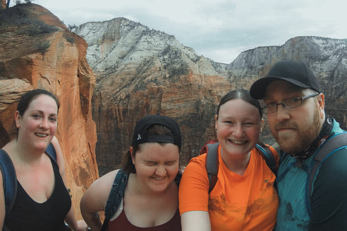 hiking angels landing group of friends expensive camera equipment