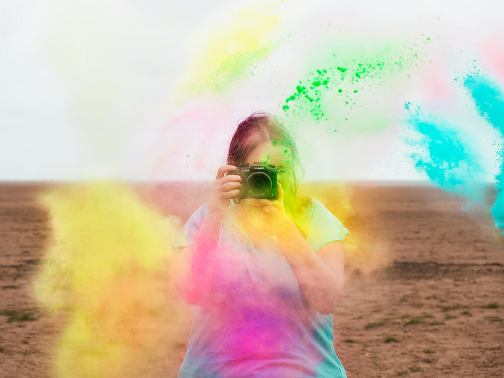 a woman being splashed with paint powder paint powder photography
