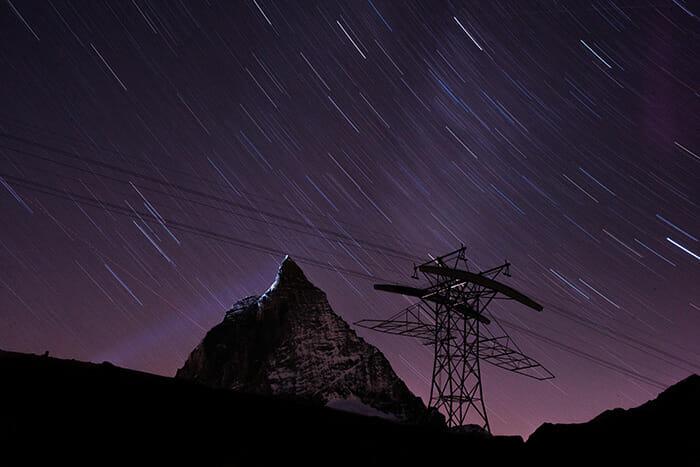 night's sky with streaking stars