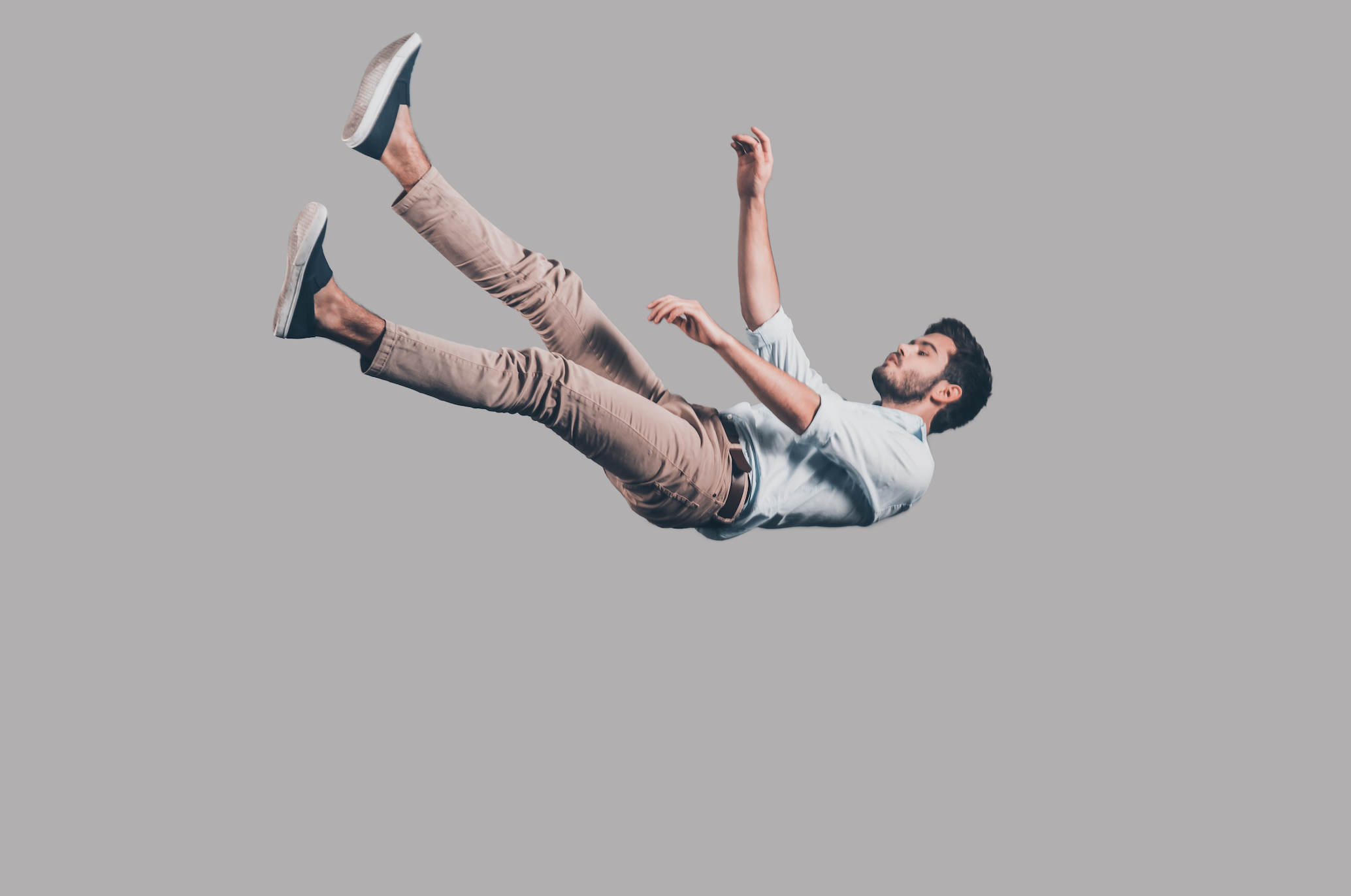 a man falling with his eyes closed