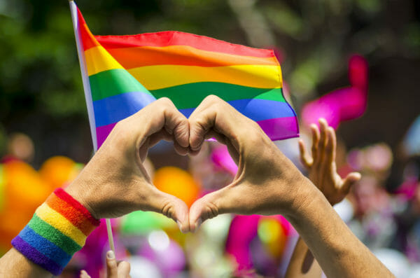 pride flag and hand heart LGBTQ+ photography