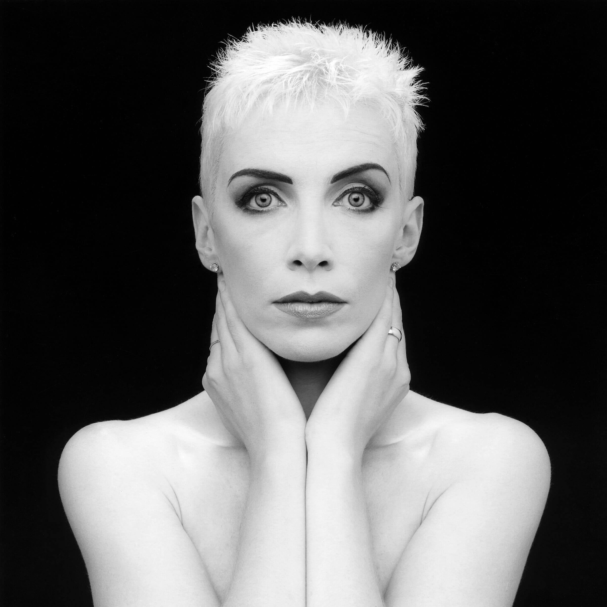 annie lennox touching her face