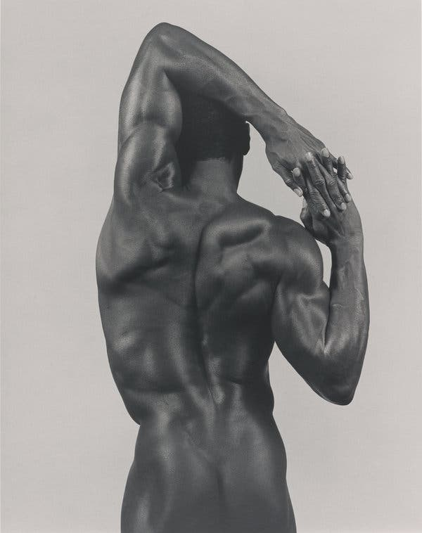 a muscular man with his back turned  LGBTQ+ photography