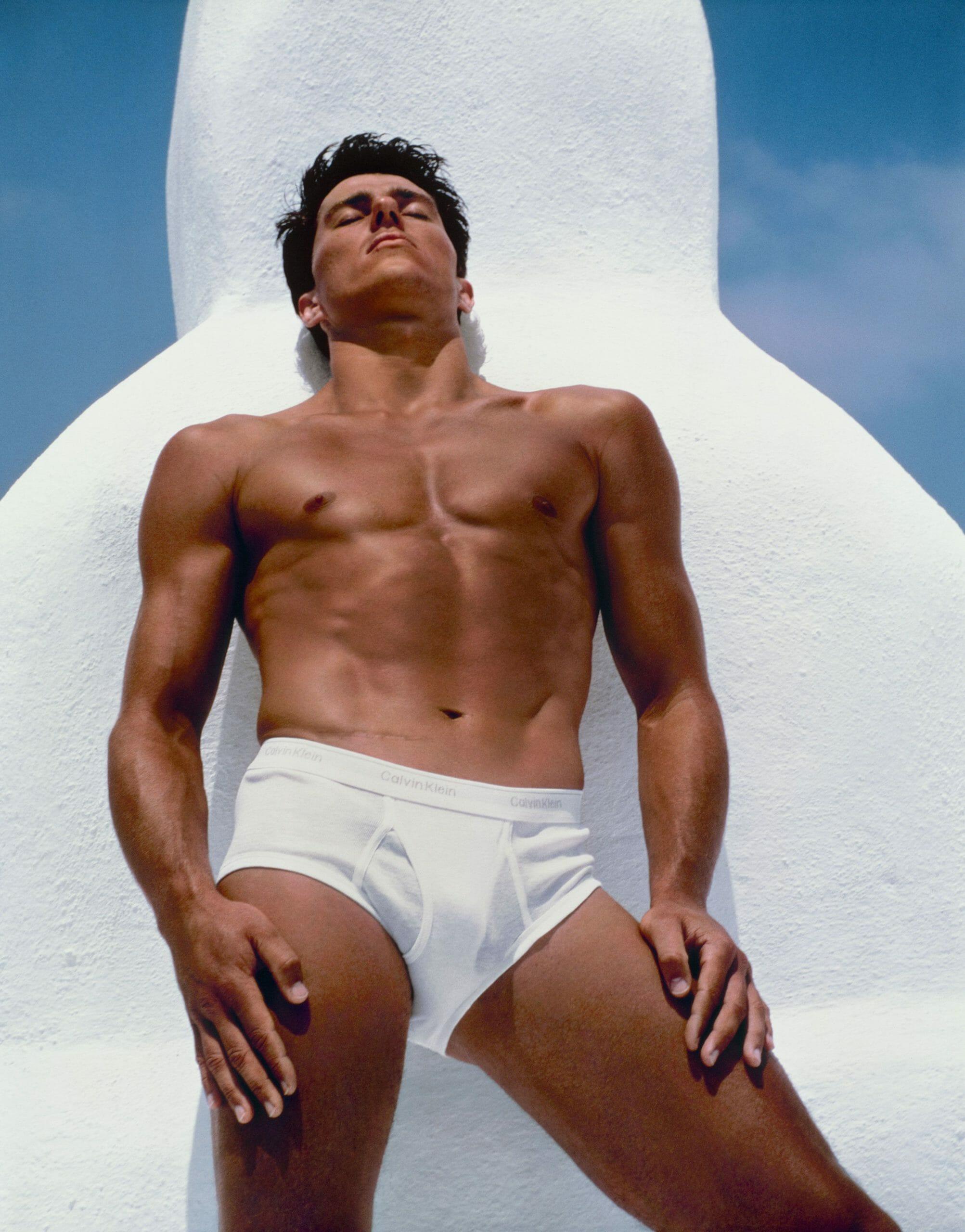 Bronzed muscular man in underwear sunbathing LGBTQ+ photography