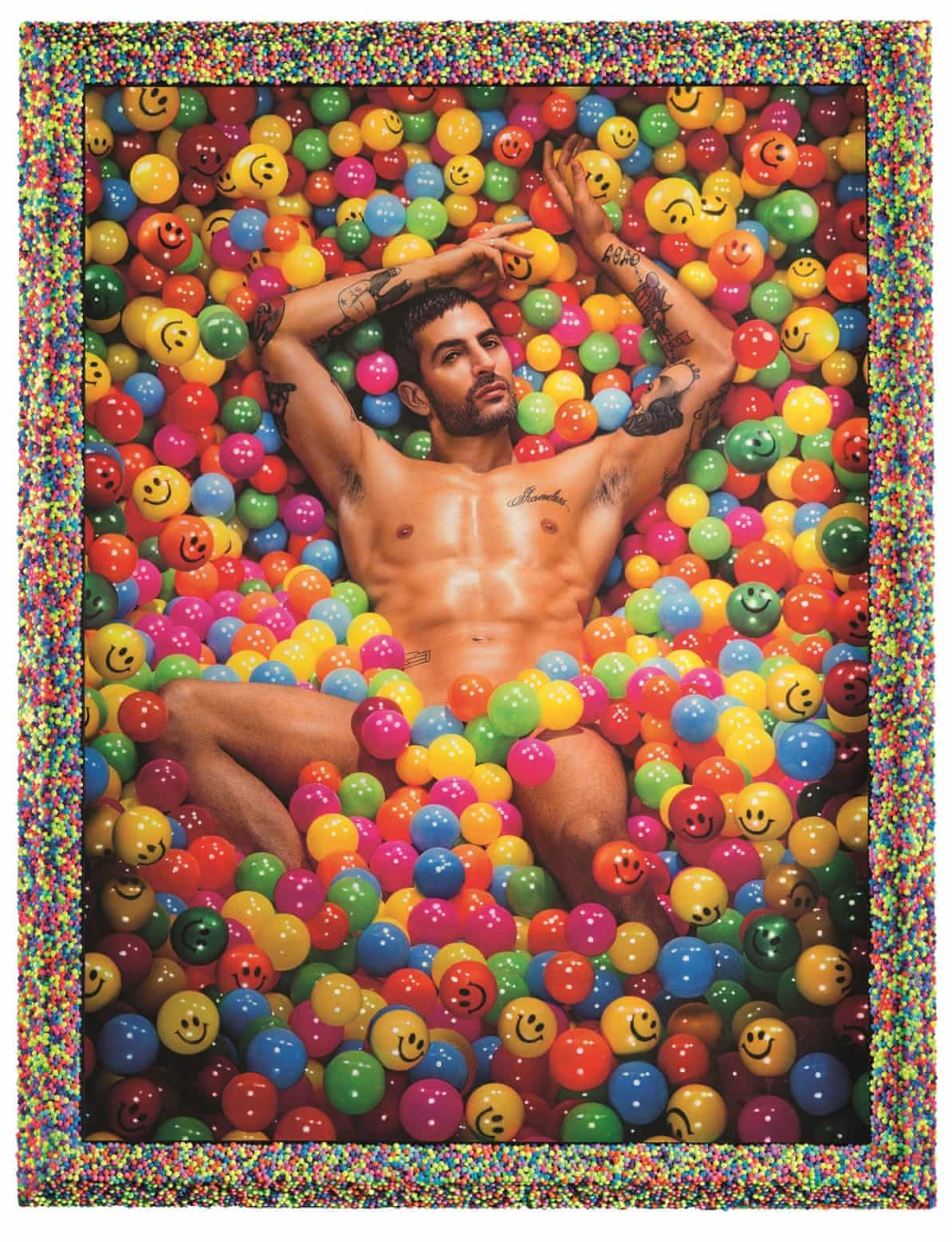 Naked man in a ball pool