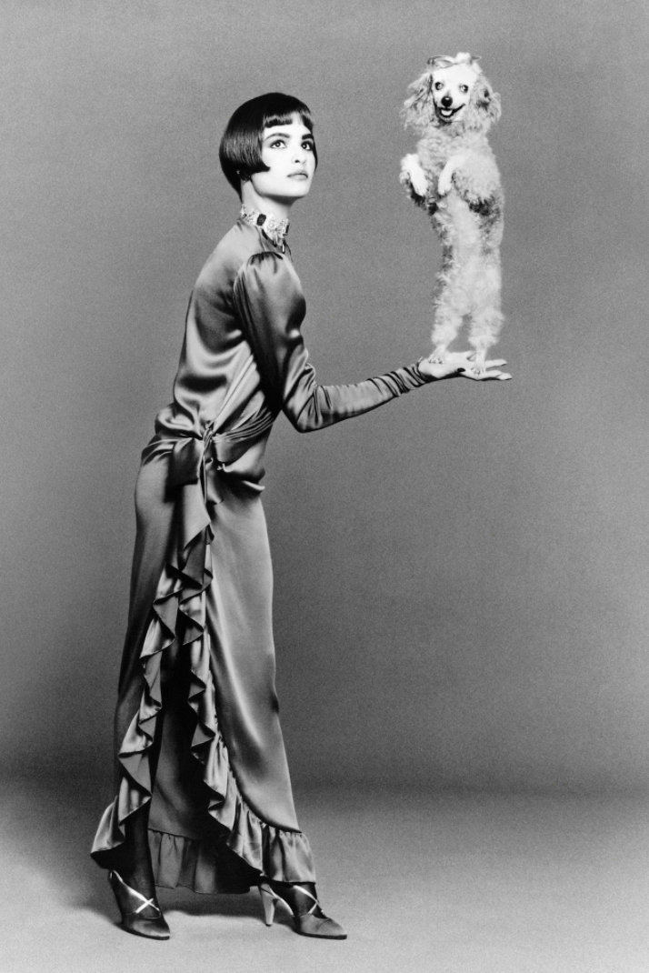 a woman holding a poodle standing on his hind legs LGBTQ+ photography