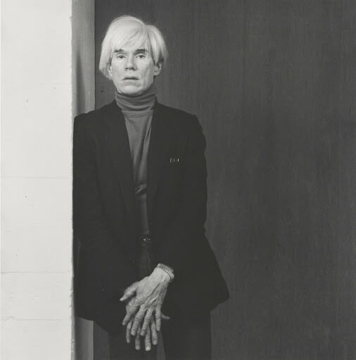 andy warhol leaning on a wall