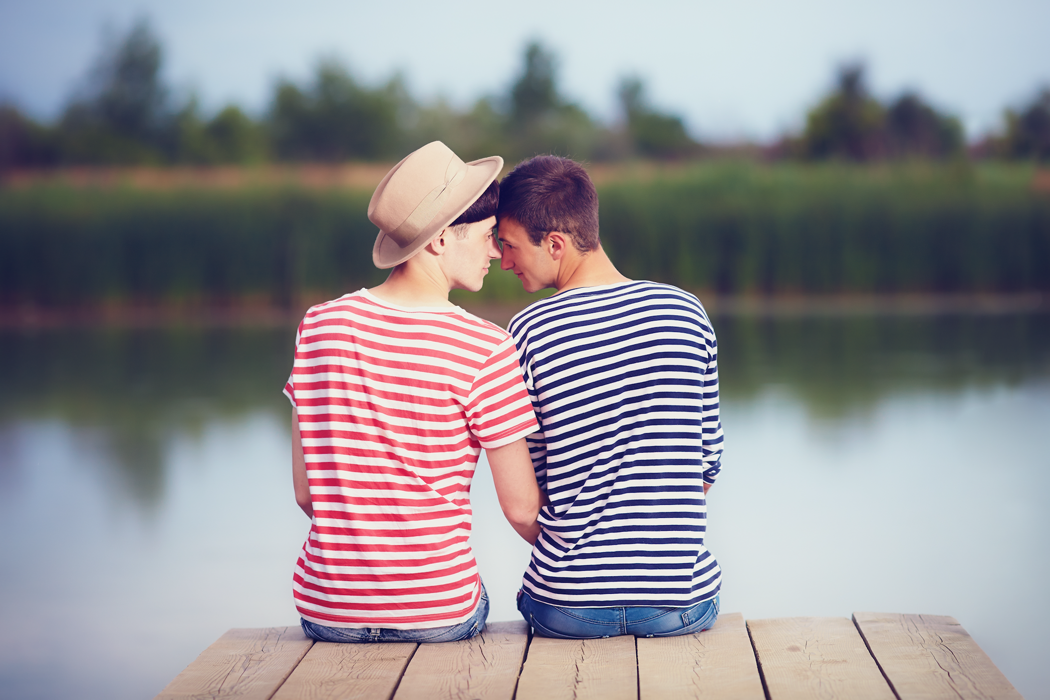a couple sharing a moment next to a lake