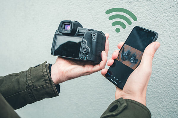 what camera is best iphotography man with camera connecting phone via wifi