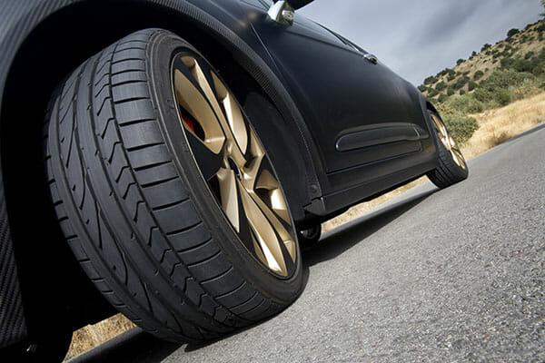 car photography blog low angle car wheel turned gold alloys