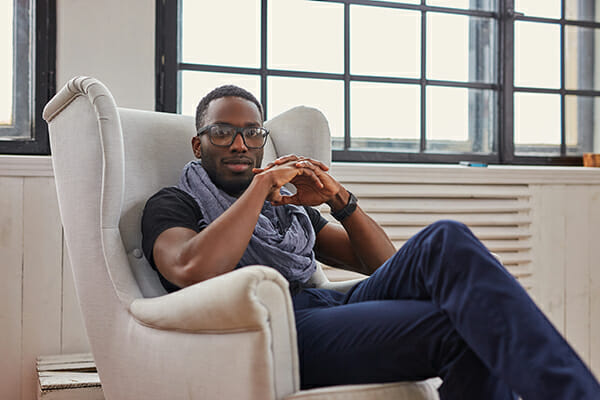 posing men blog image man sat in chair with glasses on