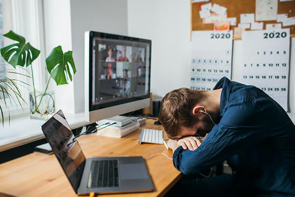 how to motivate for photographers blog image man with head on desk in front of computer