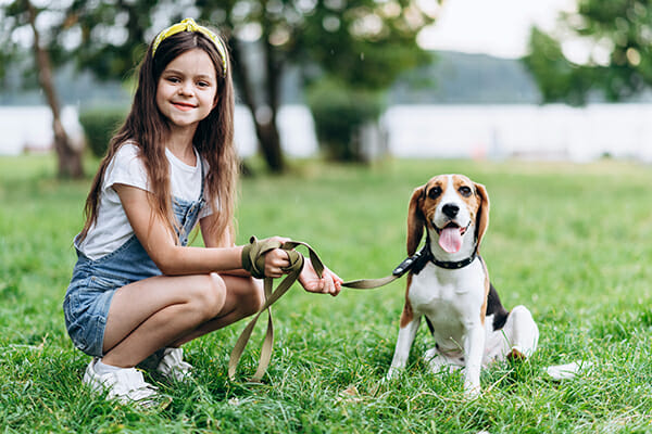 pet photography girl crouched with dog sat on lead 1