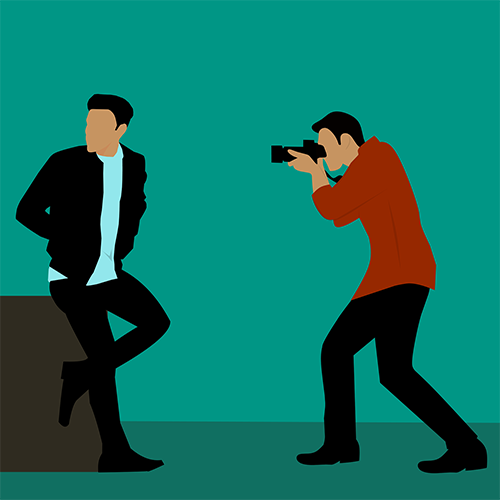 photographer taking portraits of man